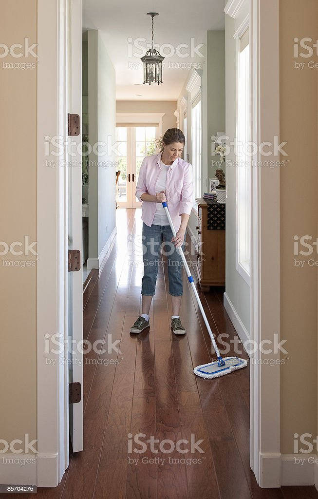 Woman Sweeping Floor in the Home royalty-free stock photo