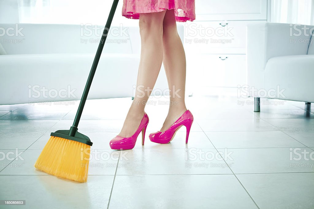 Woman sweeping royalty-free stock photo