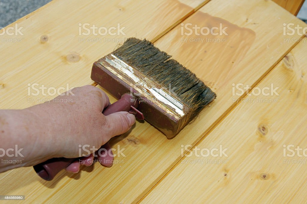 woman sweeps with a brush stock photo