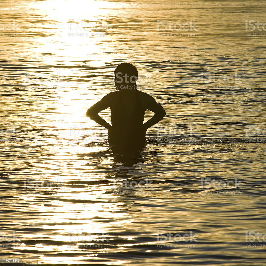 woman swimmer silhouette at sunset royalty-free stock photo