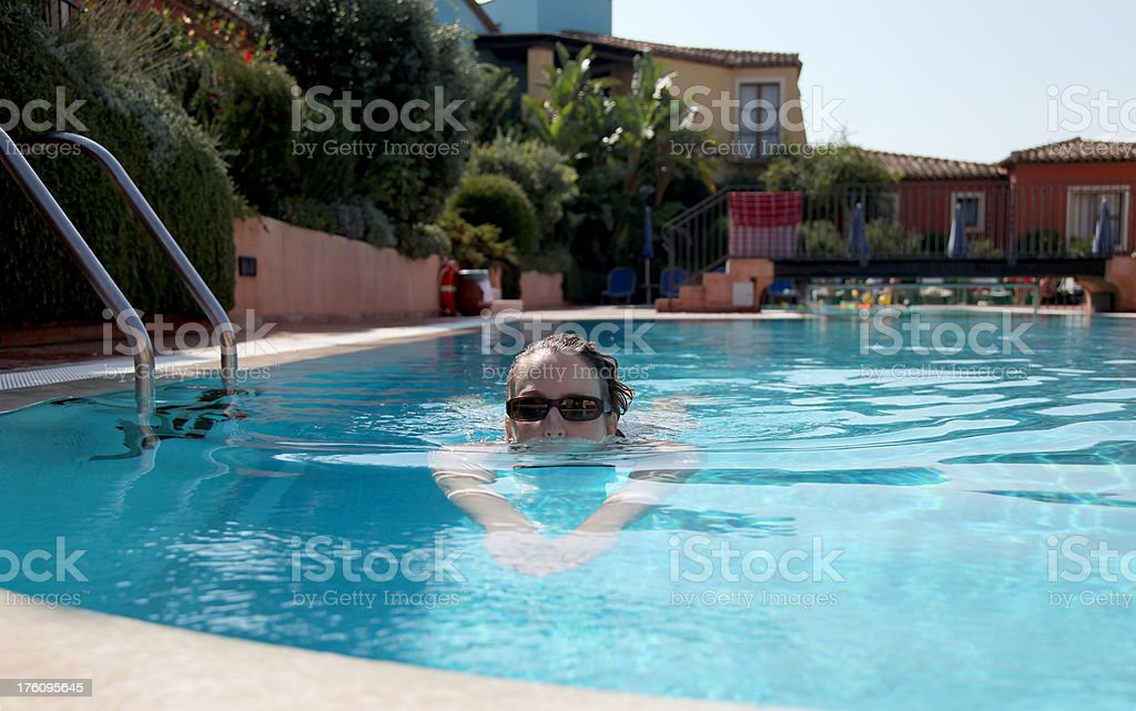 Woman swimming in a Pool royalty-free stock photo