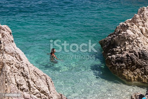 Woman swimming in clear sea
