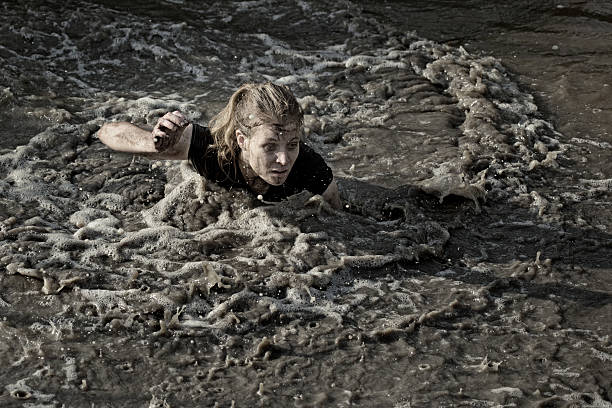Best Woman Swimming In Dirty Water Stock Photos, Pictures & Royalty