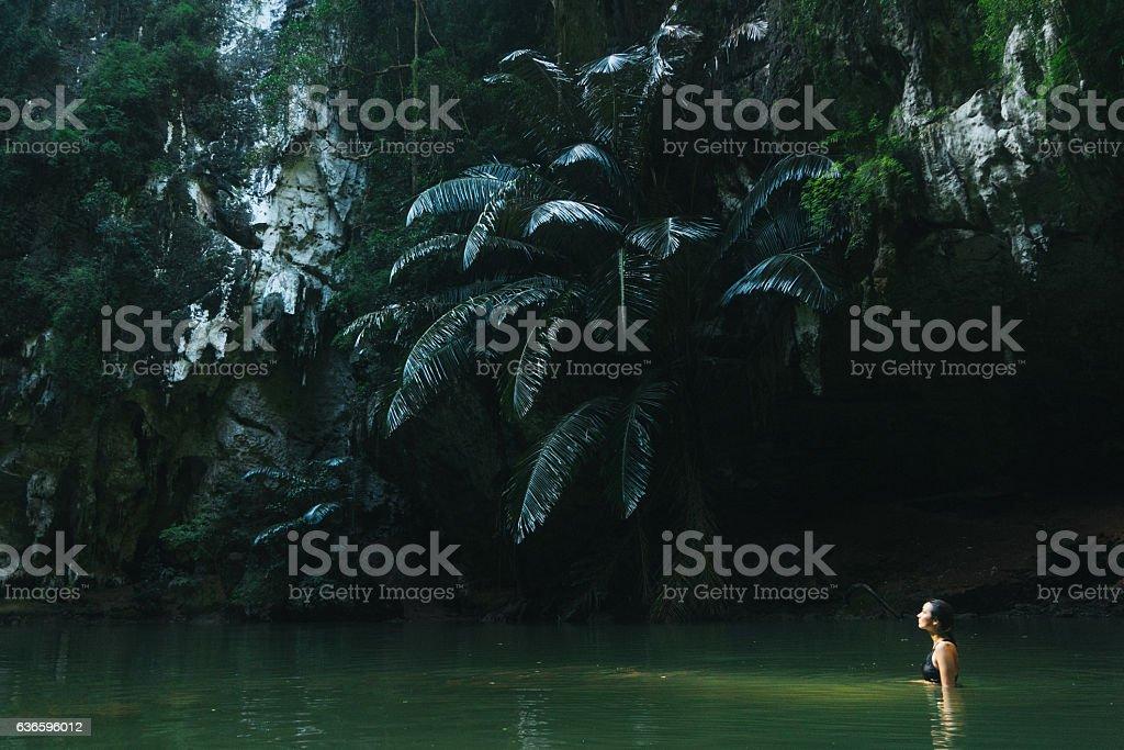 Woman swimming in lagoon stock photo