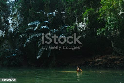 Young Caucasain woman swimming in lagoon in Thailand