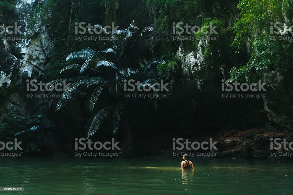 Woman swimming in lagoon stock photo