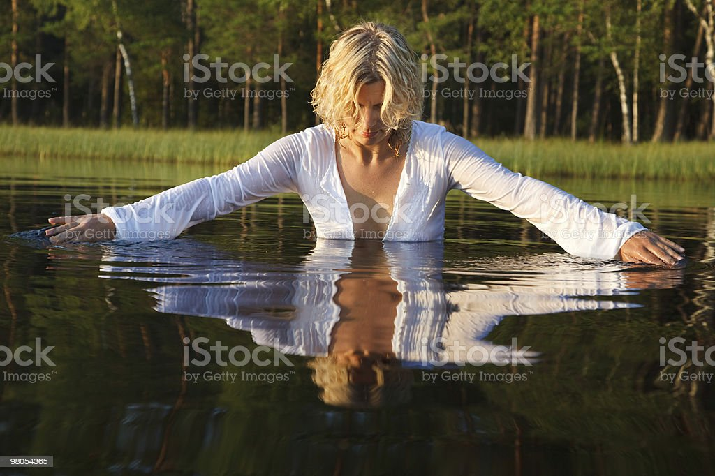 Woman swimming in lake royalty-free stock photo
