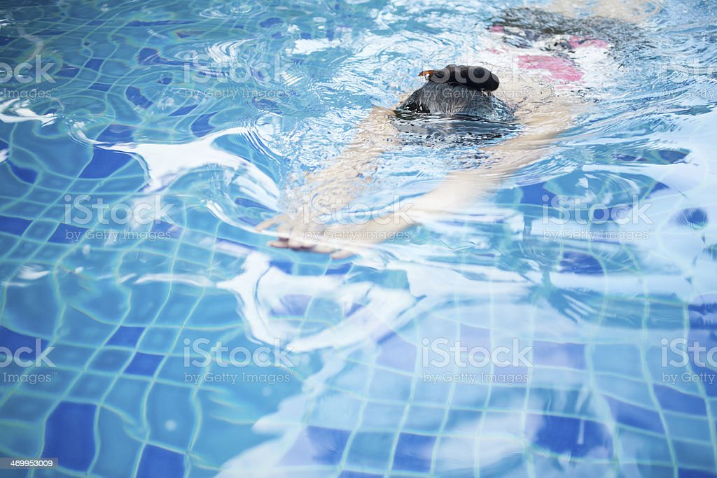 Woman Swimming in Pool royalty-free stock photo