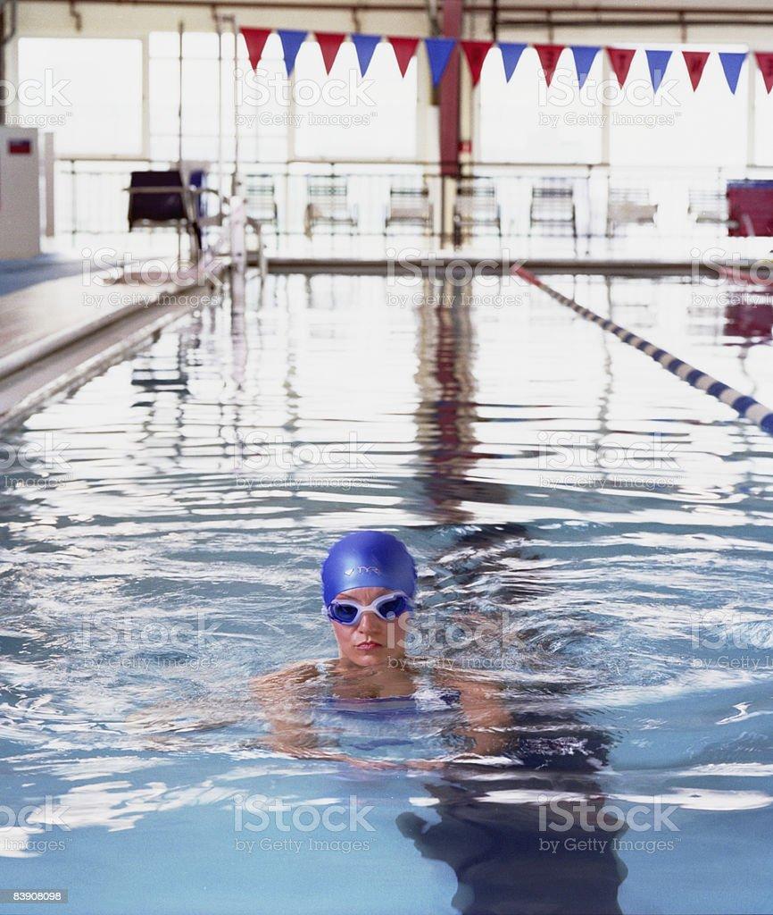 Woman swimming laps royalty-free stock photo