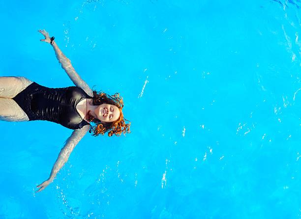 woman swimming water stock photo