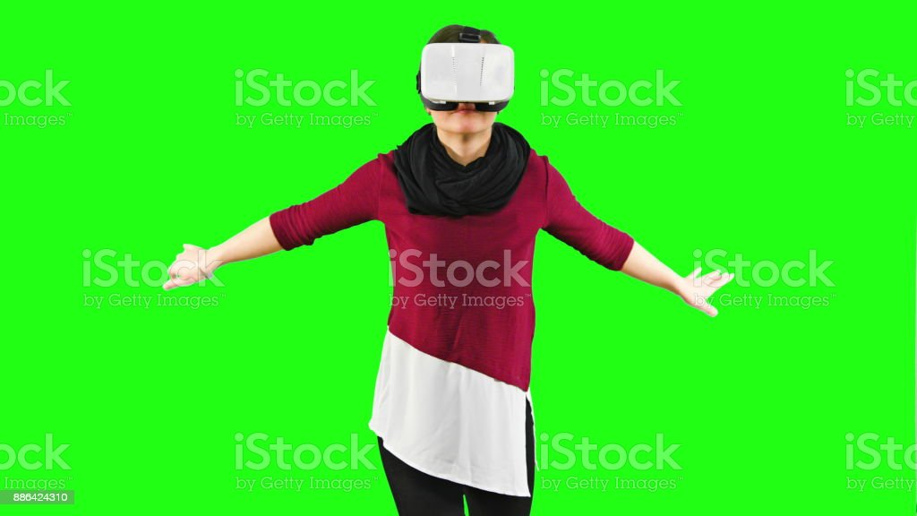 Woman Swimming with a VR Headset On stock photo