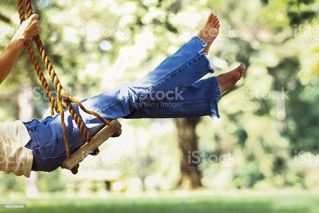 Woman Swinging stock photo