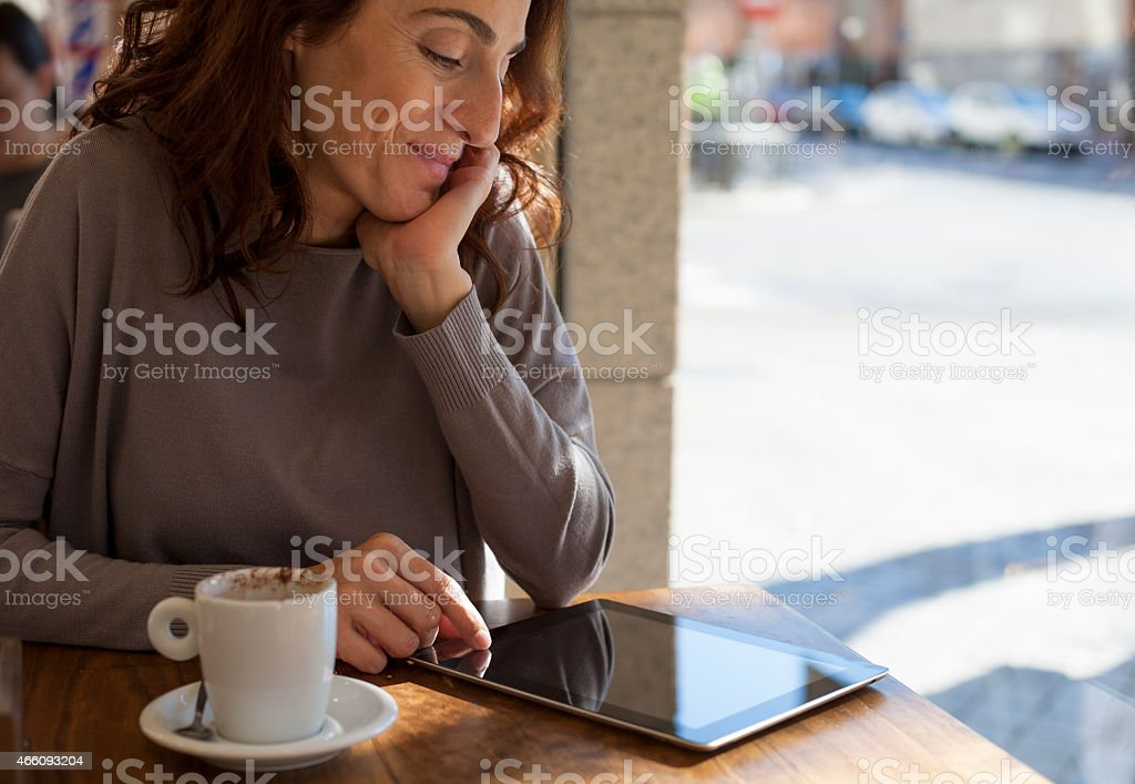 woman tablet in cafe horizontal stock photo