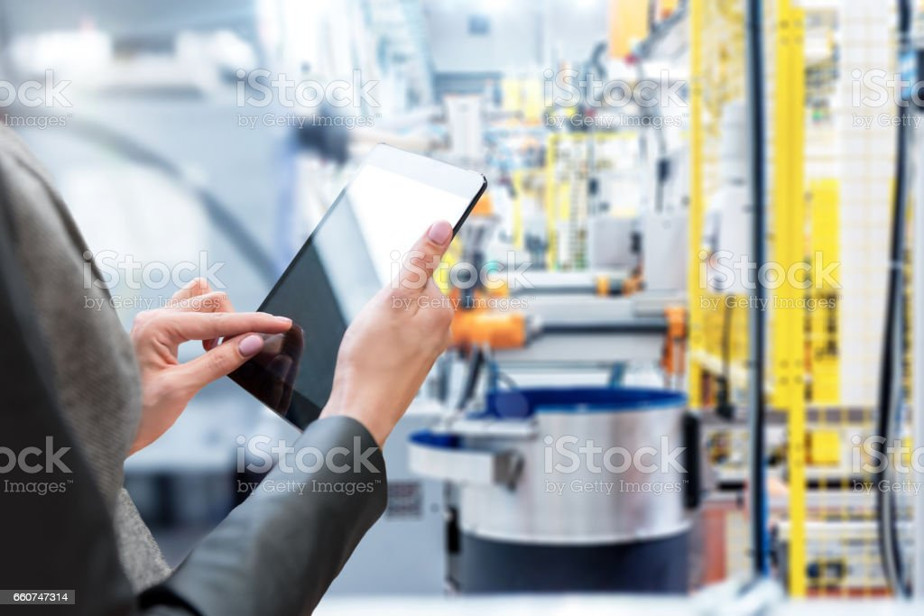 Woman & Tablet & Robotic smart machines stock photo