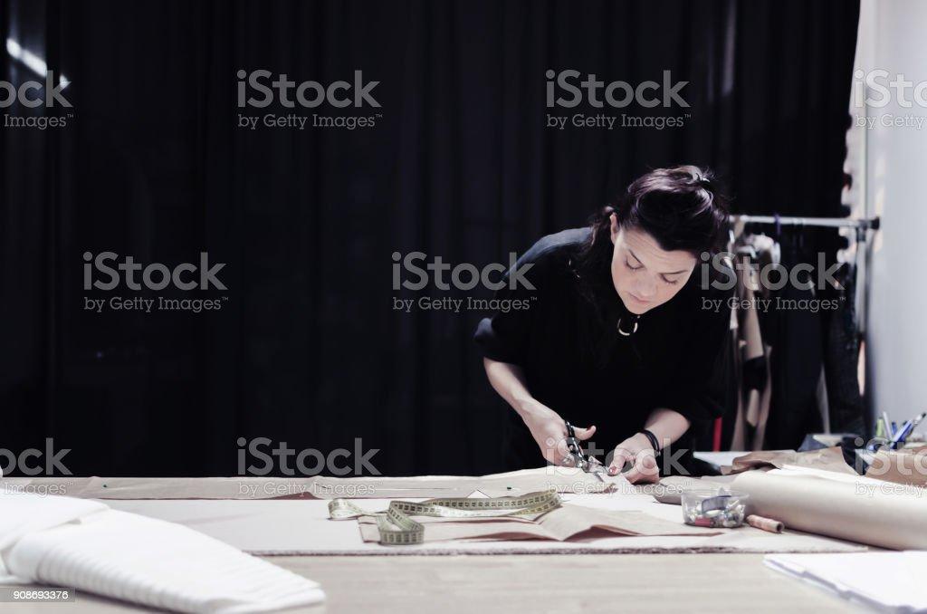 woman tailor cuts scissors stock photo