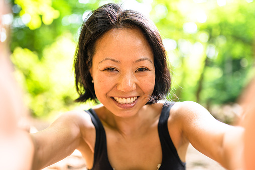 istock woman take a selfie on the wood during the jogging 577629246