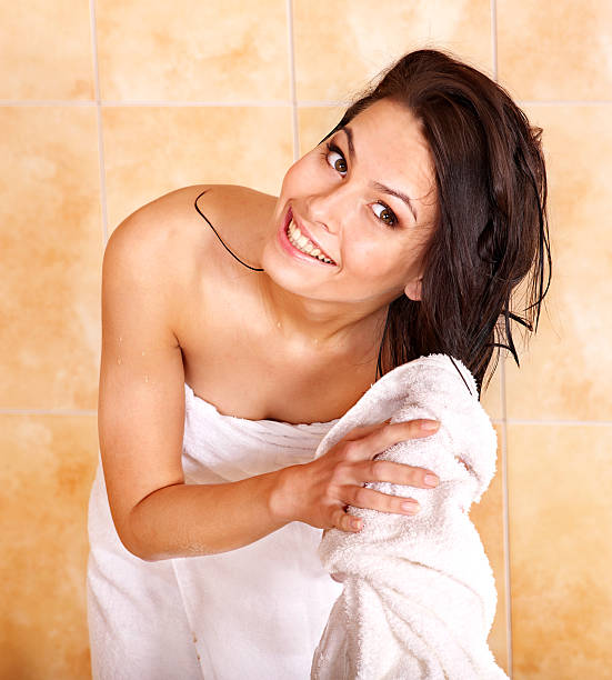 Woman take bubble  bath Young woman take bubble  bath. Girl happily wipes hair towel wet hair stock pictures, royalty-free photos & images
