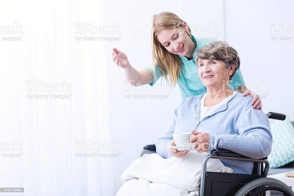 Woman take care of patient stock photo