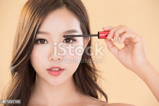 istock woman take makeup brush 871031150