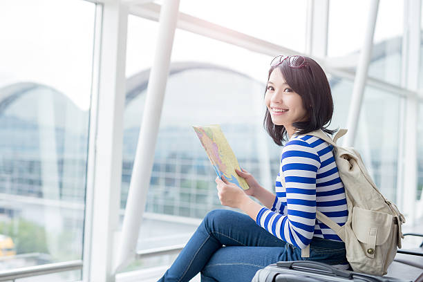 woman take map and smile stock photo