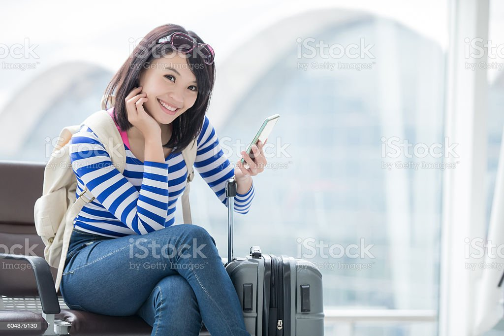 woman take phone and smile stock photo