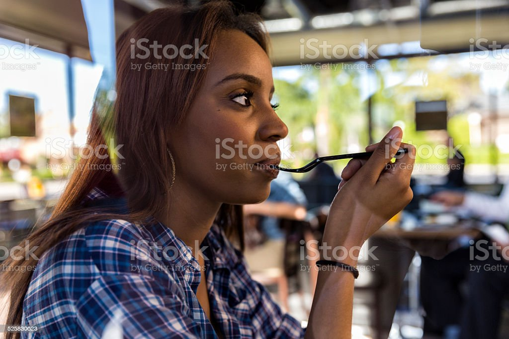 Woman Takes a Bite at a Restaurant stock photo