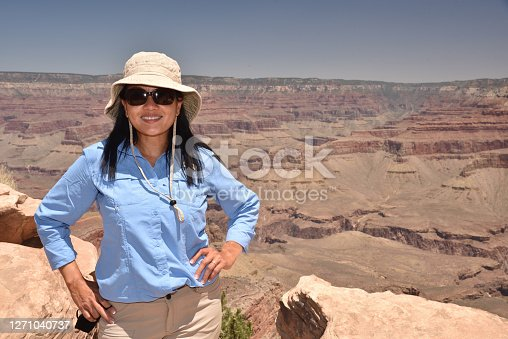 istock Woman takes a break from hiking the Grand Canyon, Arizona 1271040737