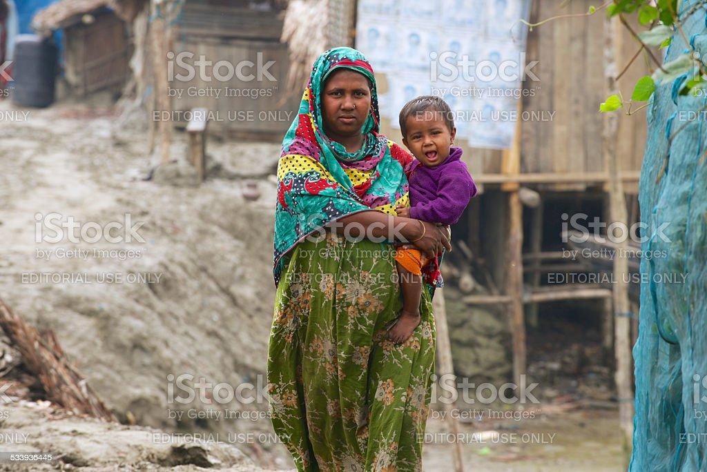 Woman takes care of her baby, Mongla, Bangladesh. stock photo