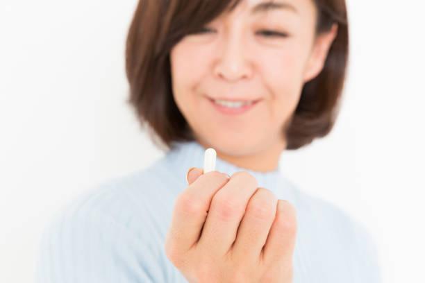 kvinna tar medicin kapslar - mature woman fever on white bildbanksfoton och bilder