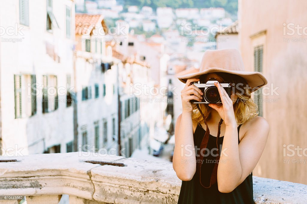 Woman takes photo  in Dubrovnik stock photo