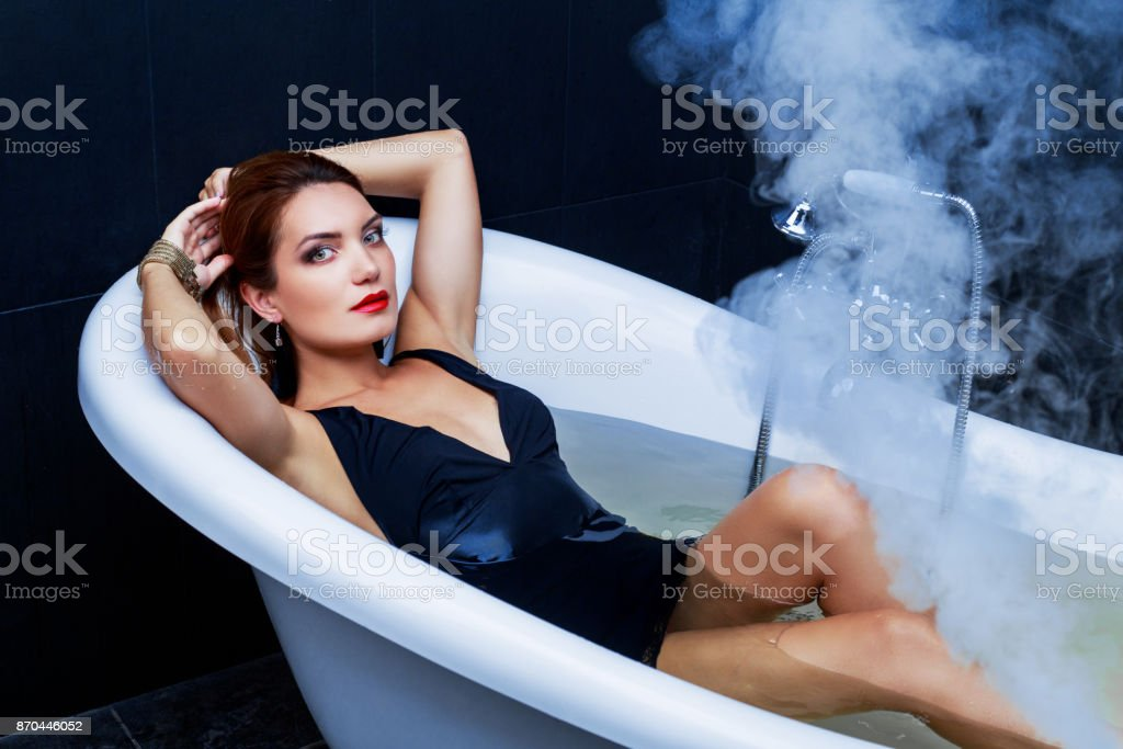 woman takign a bath stock photo