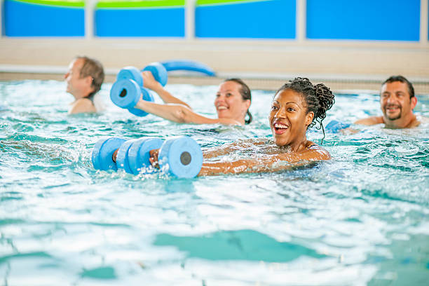 Woman Taking a Aerobic Fitness Class in the Pool stock photo