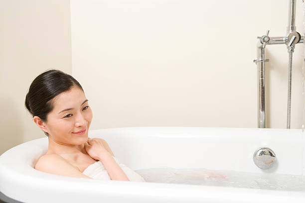 woman taking a bath - japanese bath woman bildbanksfoton och bilder