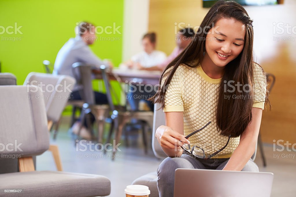 Woman Taking A Break Working In Design Studio stock photo