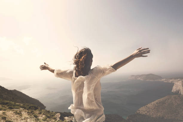 woman taking a breath in front of a spectacular view - infinity stock photos and pictures