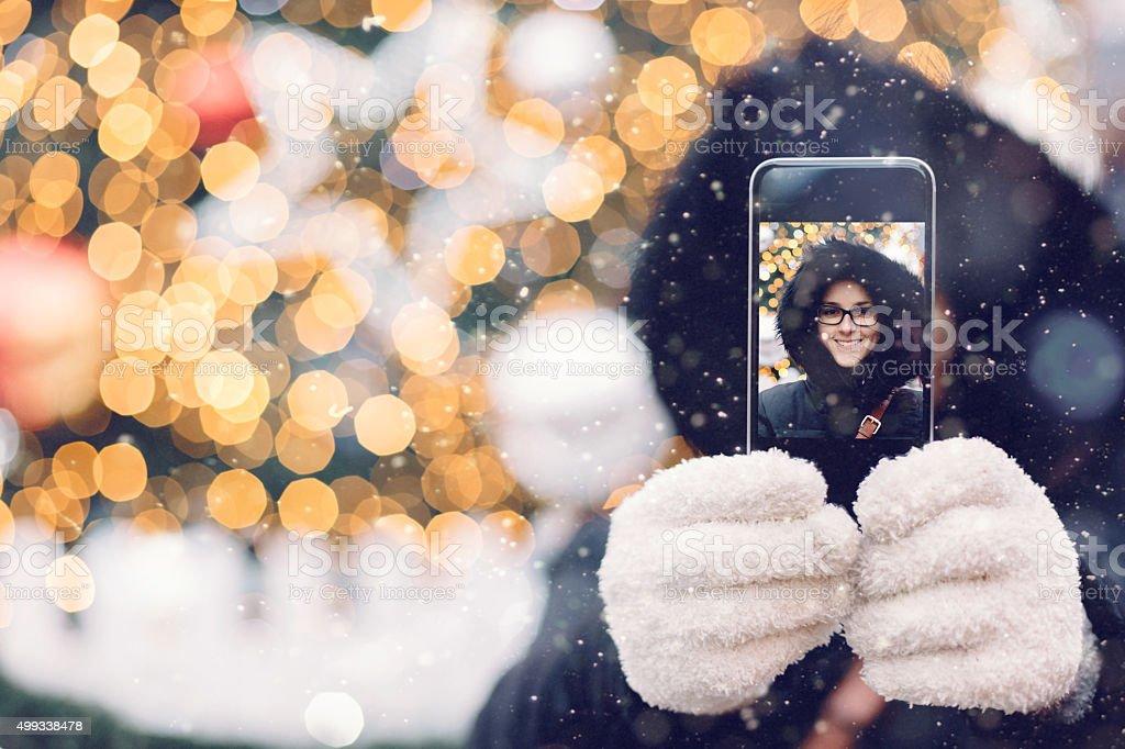 Woman taking a Christmas selfie stock photo