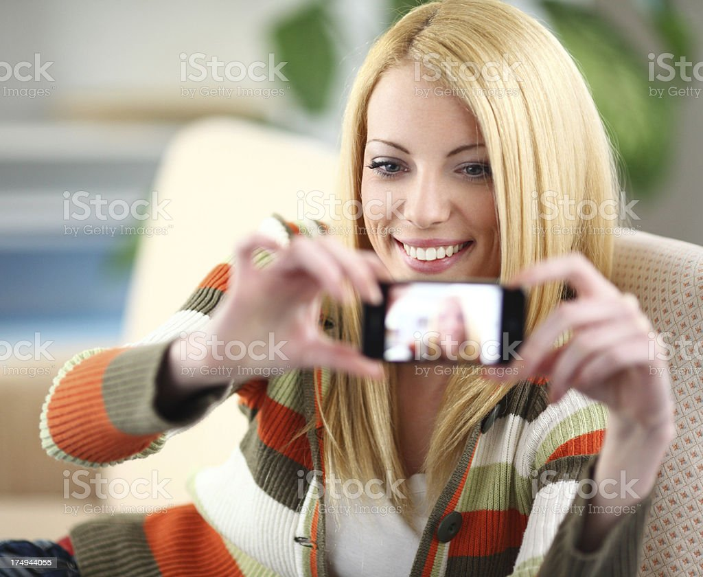 Woman taking a picture of herself. royalty-free stock photo