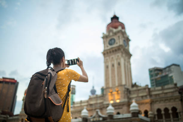 Woman taking a picture of the Sultan Abdul Samad Building stock photo