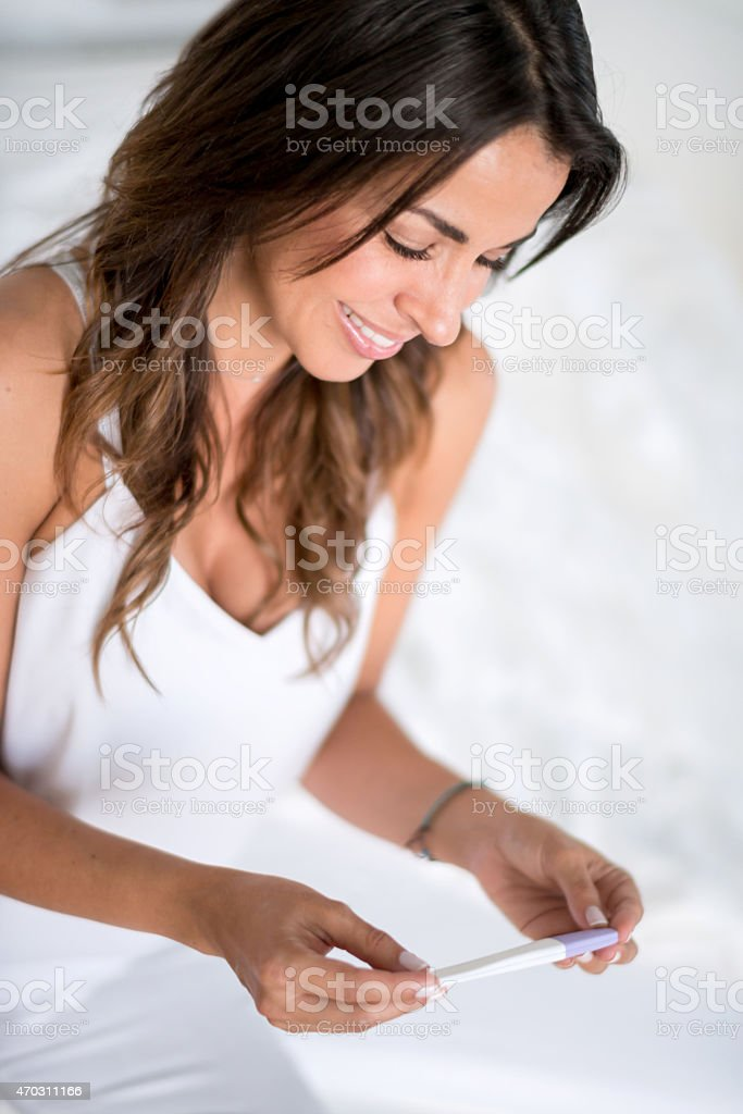 Woman taking a pregnancy test stock photo