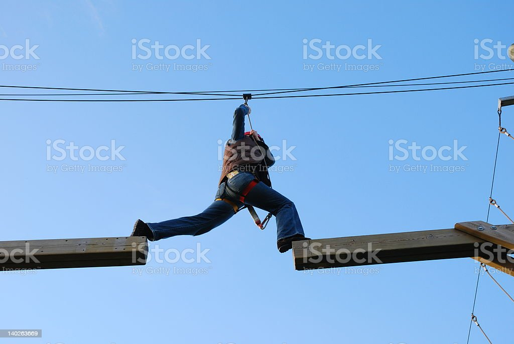 Woman taking a risky jump royalty-free stock photo