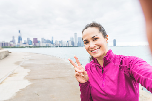 Woman taking a selfie after workout in Chicago