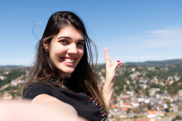 Woman taking a selfie in Campos do Jordao, Sao Paulo, Brazil stock photo