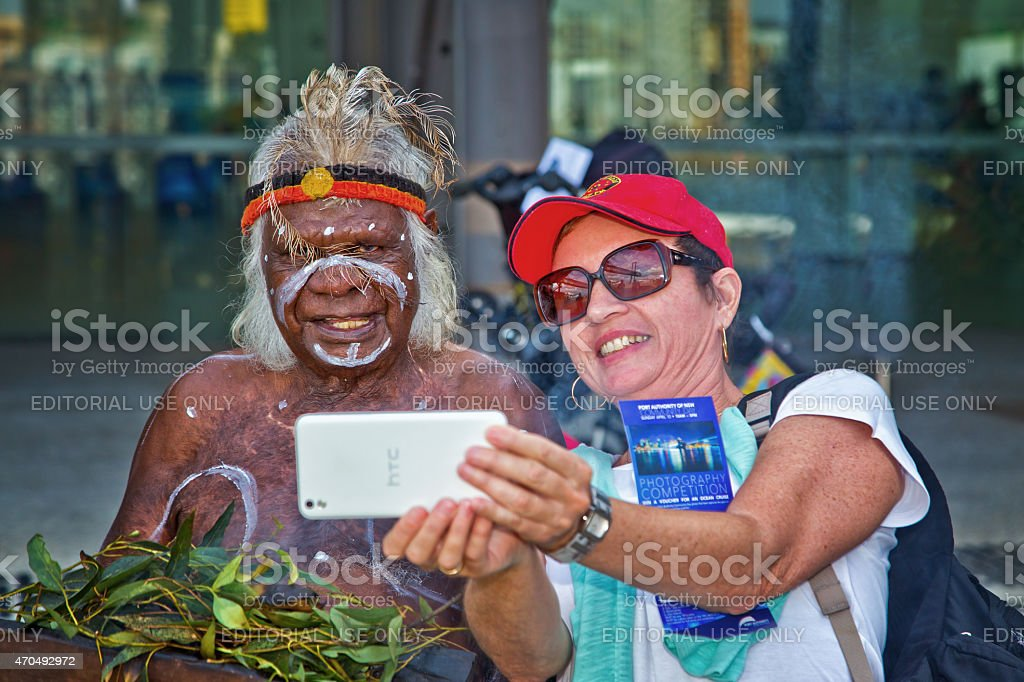 Woman taking a selfie with an Australian aborigine stock photo