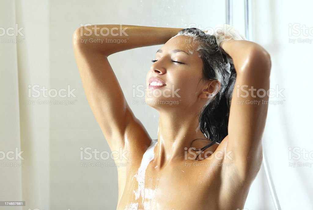 Woman taking a shower. stock photo
