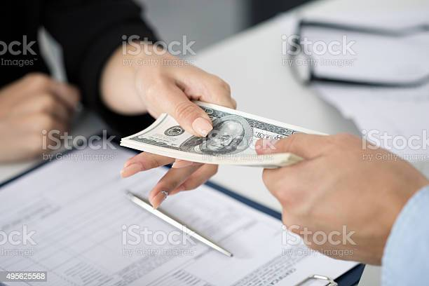 Woman taking batch of hundred dollar bills picture id495625568?b=1&k=6&m=495625568&s=612x612&h=hb nx tqoa4cxexxqwrobpfyve  1ukjfsa su7cfpm=