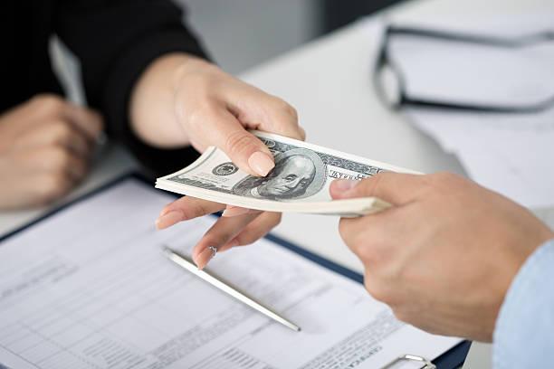 Woman taking batch of hundred dollar bills picture id495625568?b=1&k=6&m=495625568&s=612x612&w=0&h=ttybtuhijpzxkbc2m5 iarzmrkywwytxg4ez4vn5b70=