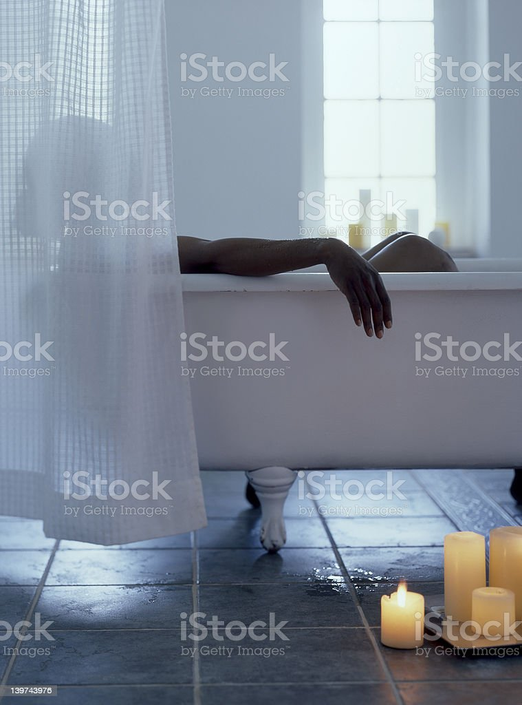 Woman taking bath stock photo