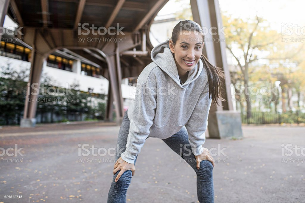 Woman taking break after a run stock photo