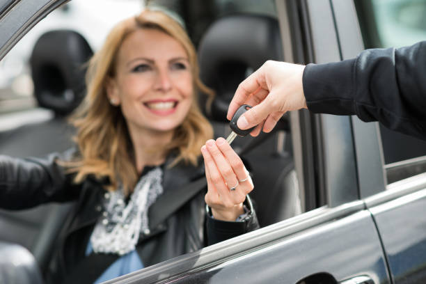 Woman taking car keys stock photo