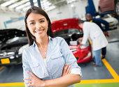 istock Woman taking car to the mechanic 507652459